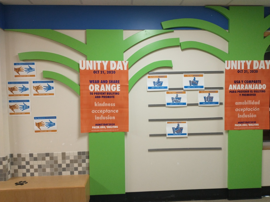 Unity Day posters and Word Cloud projects from each classroom on display outside the Media Center