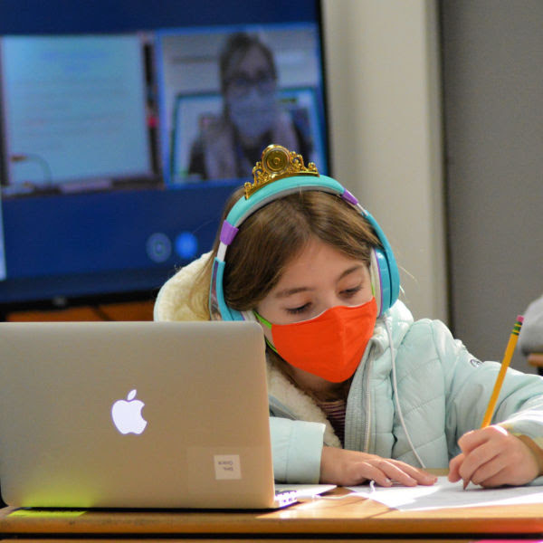 student in class wearing a mask
