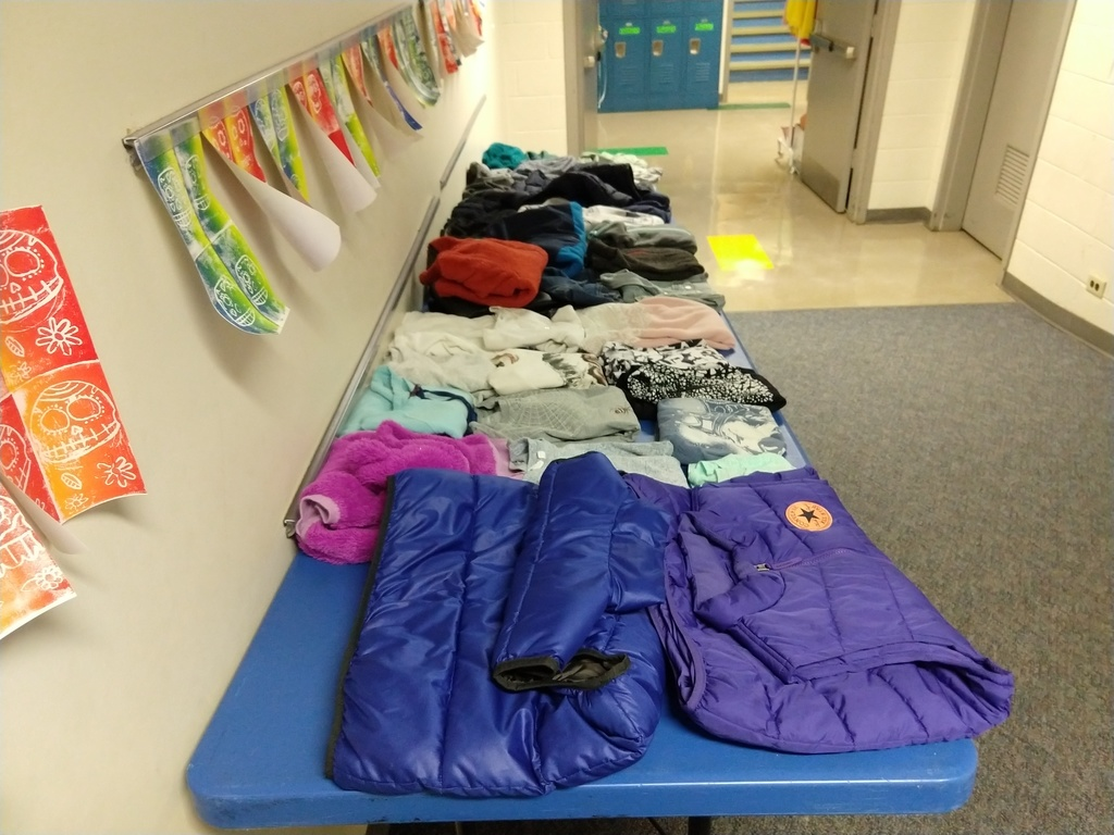 Many jackets and sweaters displayed from the lost and found boxes
