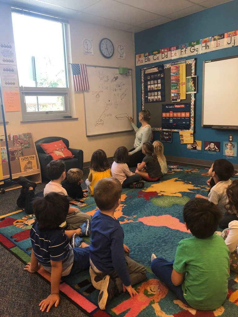 Jessie Thackrey class watches teacher draw things that begin with the letter C
