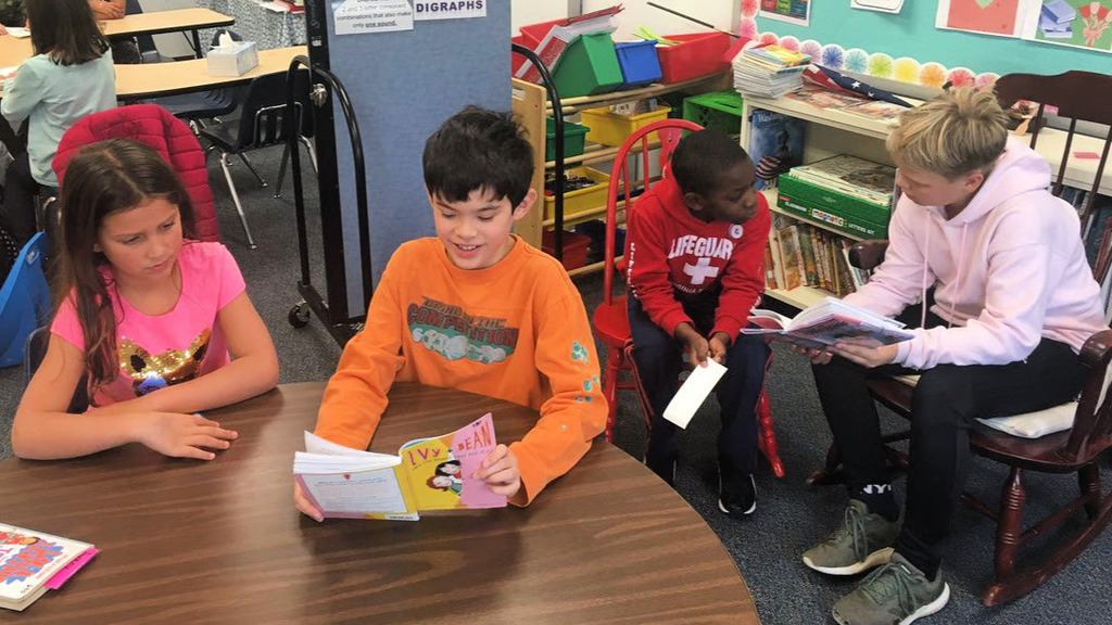 Fifth grade and second grade students read together