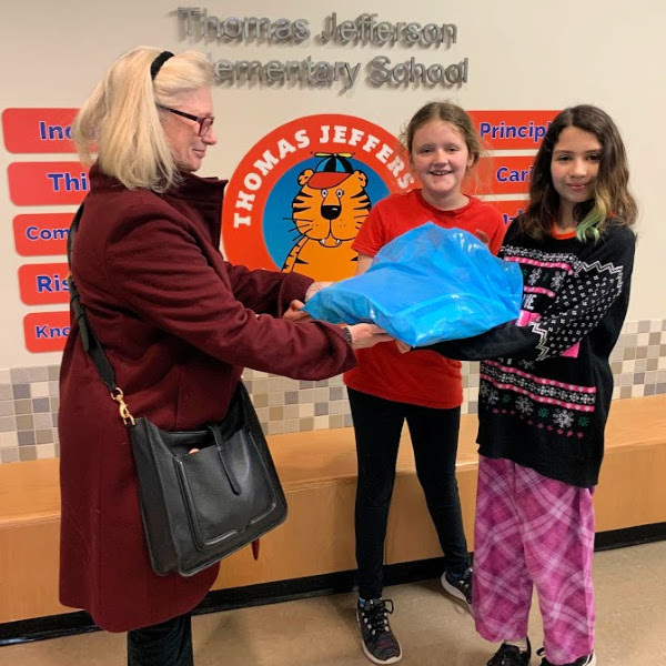 TJ SCA officers deliver cards made for service members on Veteran's Day to the DAR