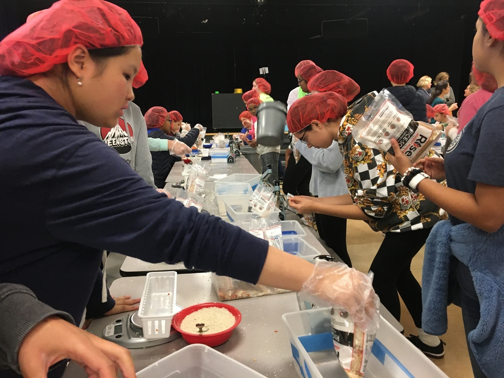 Students weigh and seal the meals.
