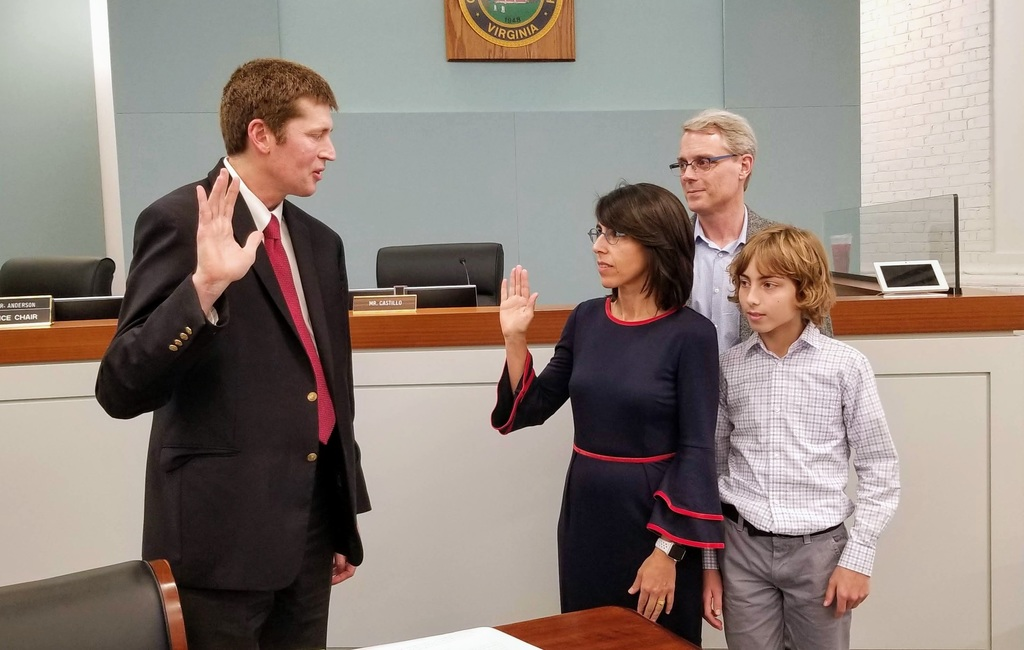 Susan Dimock takes the oath of office.