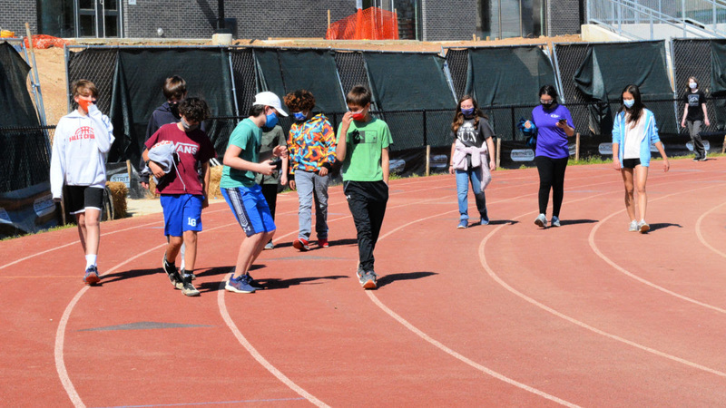 Students walking around a track